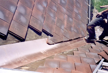 Slate Roof Central - Valley replacement on interlocking tile roof.