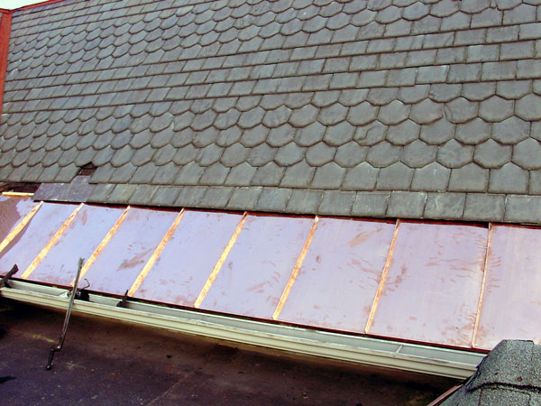 One Way To Install Standing Seam Copper Snow Aprons on a Slate Roof