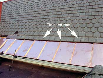 Copper Snow Aprons at slate roof central - standing seam apron installed