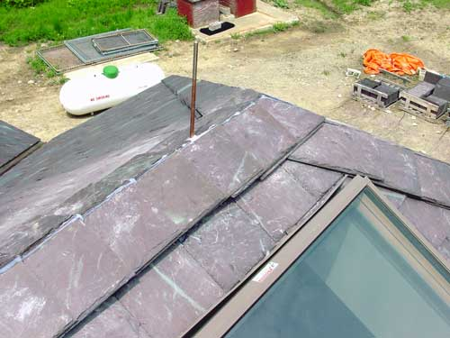 Slate Roof Central - Installing a ventilated slate roof ridge.